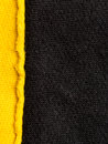 Fabric seam yellow and black background Royalty Free Stock Photography