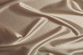 Fabric soft goods color natural fine and dense fabrics lying waves and ironed Royalty Free Stock Images