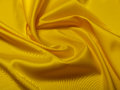 Fabric soft goods color natural fine and dense fabrics lying waves and ironed Stock Photo
