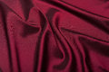 Fabric soft goods color natural fine and dense fabrics lying waves and ironed Royalty Free Stock Photography