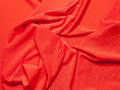 Fabric soft goods color natural fine and dense fabrics lying waves and ironed Stock Photos
