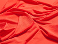 Fabric soft goods color natural fine and dense fabrics lying waves and ironed Royalty Free Stock Photo