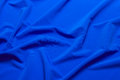 Fabric soft goods color natural fine and dense fabrics lying waves and ironed Stock Image
