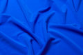 Fabric soft goods color natural fine and dense fabrics lying waves and ironed Royalty Free Stock Photos