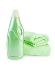 Fabric softener and towel green in the bottle two towels with a light shade on white background Stock Images