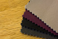 Fabric swatches a close up of a group on a wooden surface Royalty Free Stock Photography
