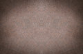 Fabric texture background of crumpled dense colored in brown tones Stock Image