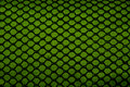 Fabric texture knitted shaped net with a green colored background Stock Photo
