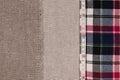 Fabrics background. Linen fabric, sackcloth, plaid flannel shirt Royalty Free Stock Photo