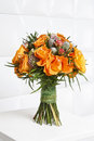 Fabulous bouquet of orange roses and other flowers