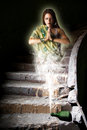 Fabulous girl genie out of the bottle in an abandoned room dark Stock Photos