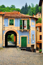 Fabulous house with an arch in the Italian court yard Royalty Free Stock Photo