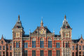 Facade of the ancient central train station in amsterdam dutch against a deep blue sky Stock Photography
