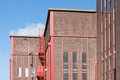 Facade from a big factory with nice red details Royalty Free Stock Photography