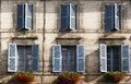 Facade blue windows flowers Brantome France Stock Photo