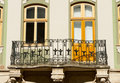 Facade of a building with a balcony. Royalty Free Stock Photo