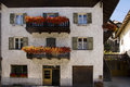 Facade and flowers nova levante italy with balconies decorated with in welschnofen a town on the dolomites Stock Image