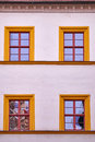 Facade with four orange framed windows Royalty Free Stock Photo