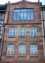 Facade of french building in modern style with windows and french balconies Royalty Free Stock Photo