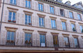 The facade of french building modern style with windows and french balconies Royalty Free Stock Photo
