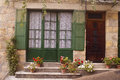 Facade with green door and flowers saint cyprien dordogne france Stock Images