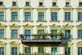 Facade of a green renovated old apartment building Royalty Free Stock Photo