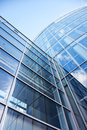 Facade of modern glass blue office and sky reflected Royalty Free Stock Photos
