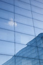 Facade of modern glass building with reflections of blue sky and Royalty Free Stock Photo
