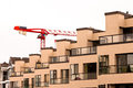 Facade of new apartment building and tower crane Stock Photography