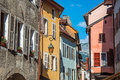 Facade of old and colorful buildings with windows in Annecy. Royalty Free Stock Photo