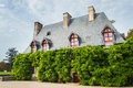 The facade of old French home covered with ivy Royalty Free Stock Photo