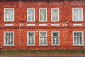 Facade of old red brick house in rybinsk russia Stock Image