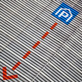Facade with parking sign and direction arrow Royalty Free Stock Photo