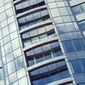 Facade part of a modern high-rise building and the reflection of clouds in its windows Royalty Free Stock Photo