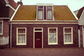 Facade of red brick home photo in the city amsterdam Stock Photo