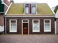 Facade of red brick home photo in the city amsterdam Stock Photography