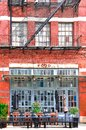 Facade of the red brick industrial building, with fire stairs. NYC Royalty Free Stock Photo