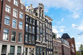 Facade of tipical amsterdam architecture and appartments in amsterdam netherlands april on april Stock Photo
