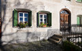 Facade of traditional house in engadin with thick walls the swiss alps Royalty Free Stock Images