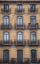 Facade with windows and balconies historic building barcelona city spain of a in the center of four floors wrought iron railings Royalty Free Stock Images