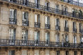 Facade, Windows and balconies of the houses in the centre of Paris, Royalty Free Stock Photo