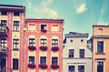 Facades of old tenement houses. Royalty Free Stock Photo