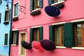 Facades and umbrellas windows in burano island in venice Stock Image