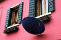 Facades and umbrellas windows in burano island in venice Royalty Free Stock Photography