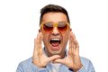 Face of angry shouting man in shirt and sunglasses Royalty Free Stock Photo