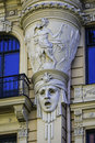 Face on art nouveau building riga latv detail of carved facade of jugendstil latvia forty per cent of buildings in central are in Stock Photo