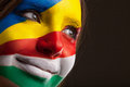 Face art painted with ukrainian and italian flags on it Royalty Free Stock Image