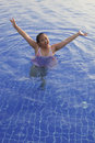 Face of asian girl in blue water pool Royalty Free Stock Images