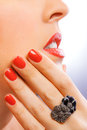 Face and beautiful red manicure on the blue Royalty Free Stock Photography