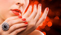 Face and beautiful red manicure on the red Stock Image